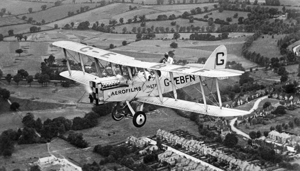 AEROFILMS PLANE. Commercial aerial photography by biplane was pioneered by Aerofilms from 1919