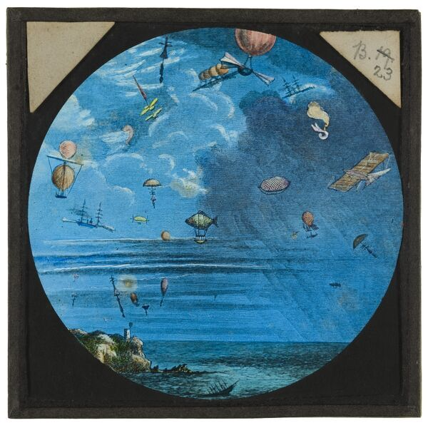 Amazing flying machines. A hand-coloured engraving of a number of early designs for a flying machines, in flight above the coast. From the Cecil Victor Shadbolt collection of lantern slides dating from 1882-1892