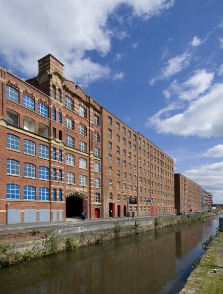 ANCOATS MILL COMPLEX, Manchester. The Rochdale canal runs past the Redhill Street Mills
