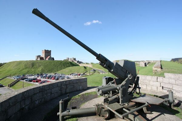 DOVER CASTLE, Kent. Anti-aircraft gun with St Mary's Church in the background