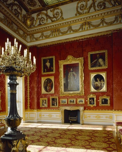 APSLEY HOUSE, London. Interior view of the North wall and fireplace in the Waterloo Gallery with one of the Siberian porphyry candelabra to the left