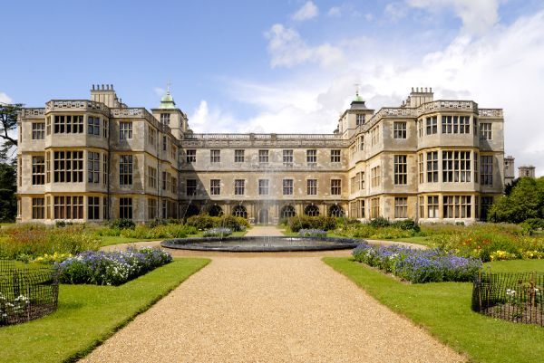 AUDLEY END HOUSE AND GARDENS, Essex. The East front and parterre garden with the fountain playing