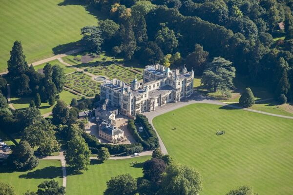 AUDLEY END HOUSE AND GARDENS, Saffron Walden, Essex. Aerial view of the grounds showing the house, service wing, parterre and parkland