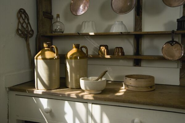 AUDLEY END HOUSE, Saffron Walden, Essex. Interior detail of the kitchen work surface and shelves with various kitchen utensils. Photographed in 2007 prior to the Service Wing upgrade