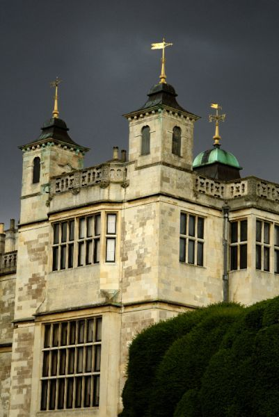 AUDLEY END HOUSE, Essex. Turrets and weathervanes on the west front viewed from north-west against a grey stormy sky