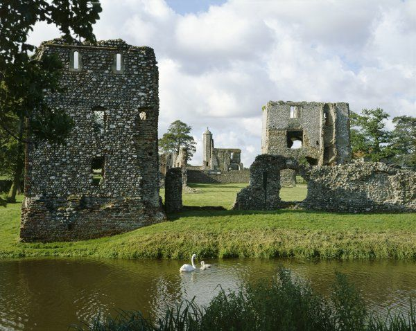 BACONSTHORPE CASTLE, Norfolk. General view of the fortified manor house from the lake