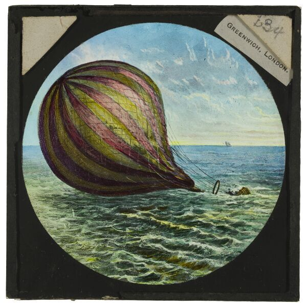 Tales of balloon flight. A hand-coloured engraving of a balloon ditched in the sea. From the Cecil Victor Shadbolt collection of lantern slides dating from 1882-1892