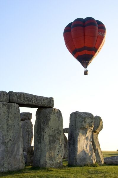 STONEHENGE. Wiltshire. Detail of the stones with a hot air balloon. This balloon flight over Stonehenge commemorated one hundred years of aerial photography, 1906-2006