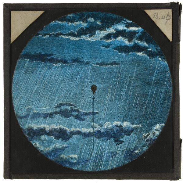 Tales of balloon flight. A hand-coloured engraving of a distant balloon ascending through clouds and rain. From the Cecil Victor Shadbolt collection of lantern slides dating from 1882-1892
