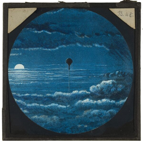 Tales of balloon flight. A hand-coloured engraving of a balloon flying through clouds above the sea at sunset. From the Cecil Victor Shadbolt collection of lantern slides dating from 1882-1892