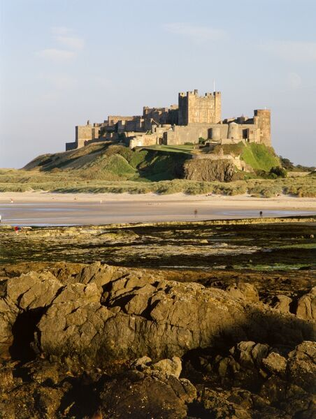 BAMBURGH CASTLE, Northumberland. General view of the castle and beach