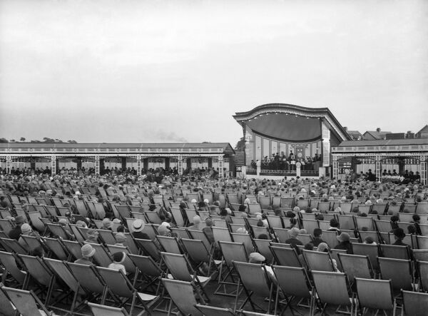 Pavilion, Happy Mount Park, Marine Road East, Bare, Morecambe, Lancashire. Rows of people seated in deckchairs for a band performance. 1925-30. Walter Scott