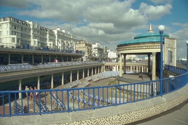 Bandstand set in a sweeping open colonnaded arcade facing two covered viewing decks topped with an open viewing area, Eastbourne, East Sussex. IoE 471323