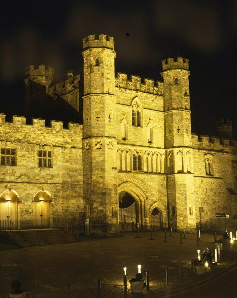 BATTLE ABBEY, East Sussex. Floodlit view of the Gatehouse from the North