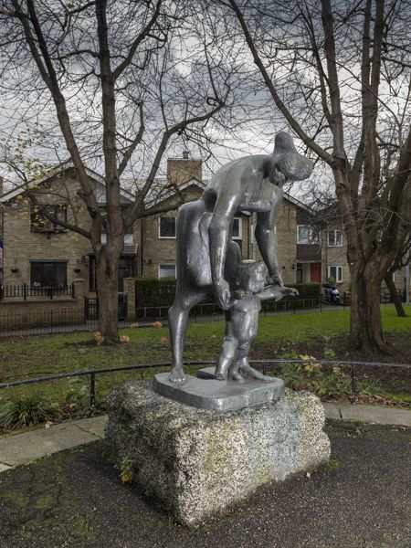 Avebury Estate, Turin Street/Gosset Street, Bethnal Green, Greater London. Franta Belsky sculpture 'The Lesson' from north east. Photographed by Chris Redgrave in 2015