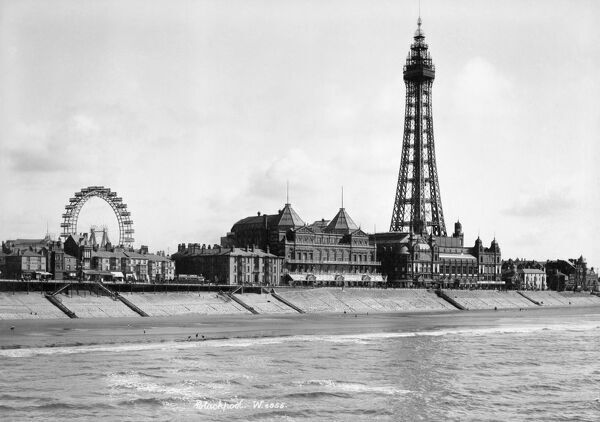 BLACKPOOL, Lancashire. A view looking south-east from the North Pier towards Blackpool Tower with the Big Wheel visible in the background. The tower was built in 1891-4 by Maxwell and Tuke and was based on the design of the Eiffel Tower in Paris