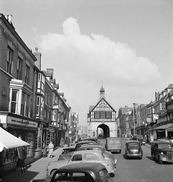BRIDGNORTH, Shropshire. A view of the High Street in 1953, looking north towards the timber-framed Town Hall in the middle of the road. John Gay