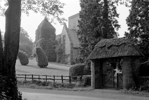 All Saints Church, Brockhampton, near Ross-On-Wye, Herefordshire. The lych gate with church in the background. This Arts and Crafts church was built by William Lethaby and completed in 1902. Photographed by Gordon Barnes in August 1970