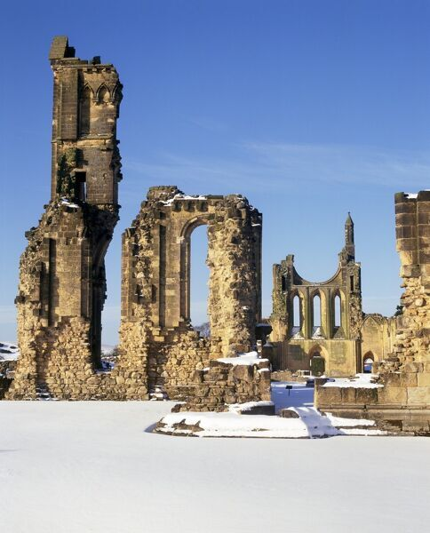 BYLAND ABBEY, North Yorkshire. View towards west front of the ruined church in the snow