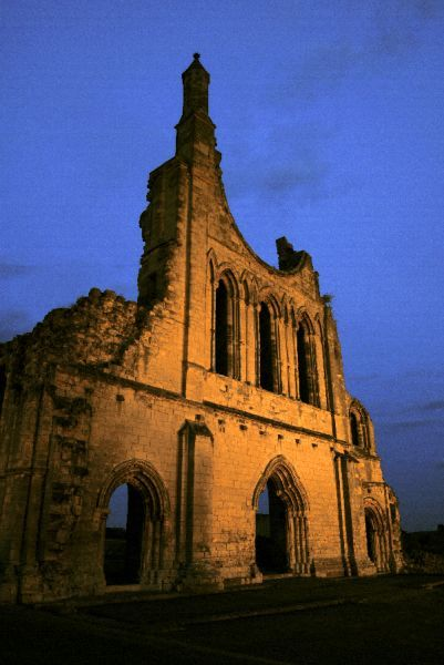 BYLAND ABBEY, North Yorkshire. The west front floodlit at sunset