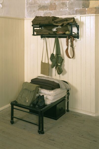 CALSHOT CASTLE, Hampshire. Keep interior. barrack room. First world war extendable bed and soldiers equipment
