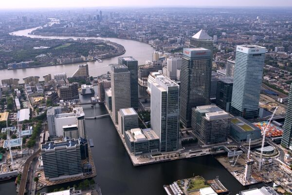 CANARY WHARF, Docklands, London. The towers of West India Dock with the River Thames beyond