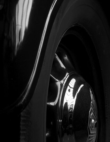 Abstract detail of black car's wheel and wheel arch