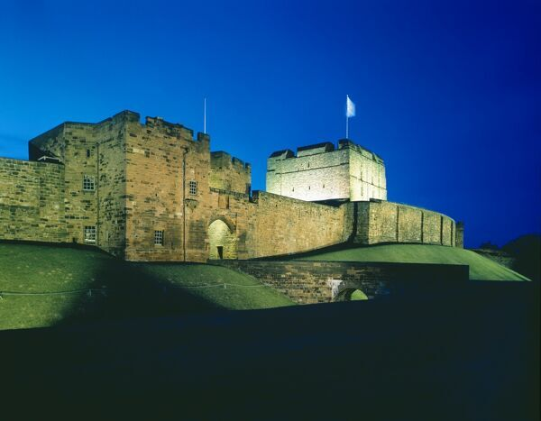 CARLISLE CASTLE, Cumbria. The Outer Gatehouse, Keep and Rampart Wall, floodlit at night