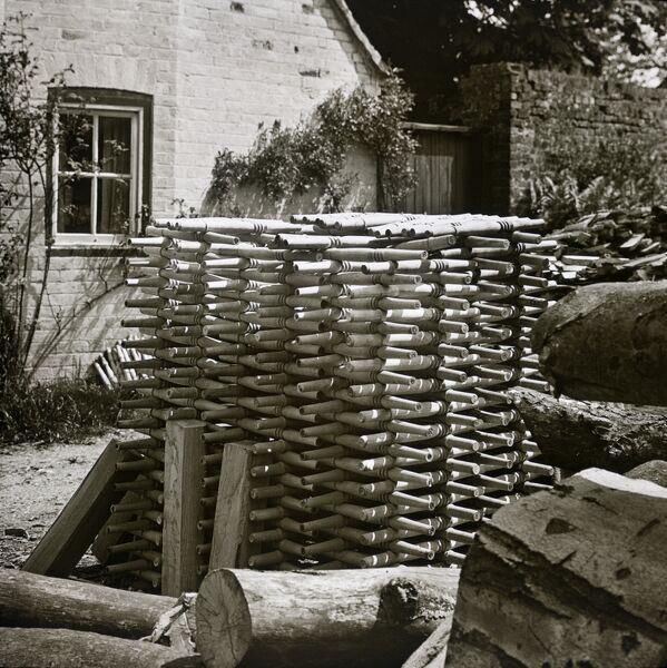 Turville, Buckinghamshire. Turned chair legs stacked prior to delivery to the factory assembly