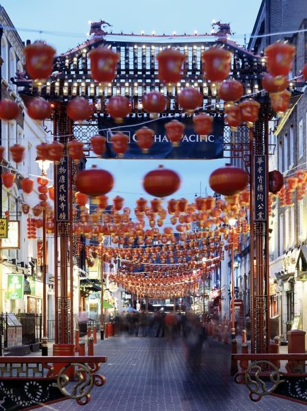 CHINATOWN, Gerrard Street, London. General view of china town at dusk showing red chinese lanterns and entrance gateway