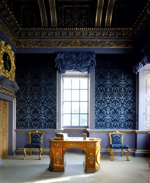 CHISWICK HOUSE, London. Interior view of the Blue Velvet Room showing library table with rounded ends and two tapestry chairs