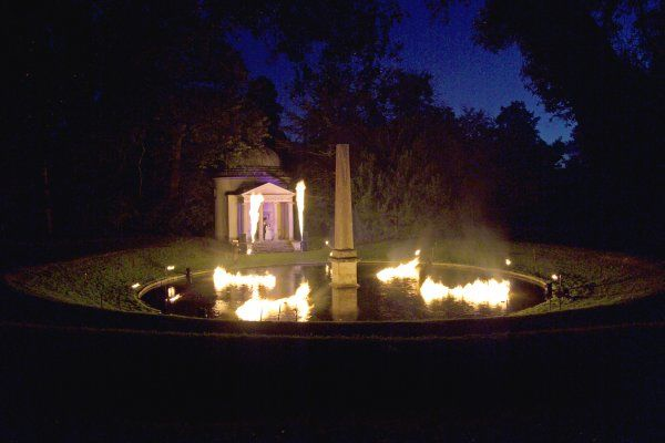 CHISWICK HOUSE, London. The Orange Tree Garden at night during the Chiswick Festival (September 2005). The Ampitheatre, Obelisk and Ionic Temple floodlit by fire