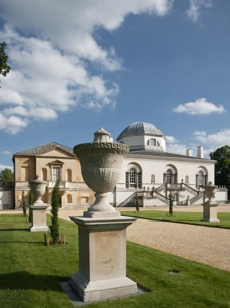 CHISWICK HOUSE, London. View of urns lining path with the North facade beyond