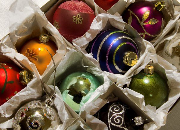 Colourful christmas baubles in boxes waiting to be displayed