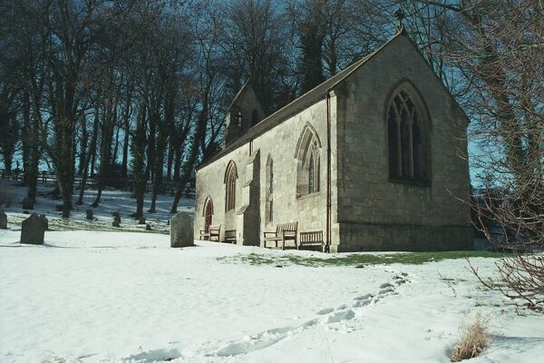 Footprints in the snow lead to the church at Millington, East Yorkshire IoE 166979