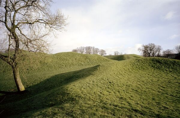 CIRENCESTER AMPHITHEATRE, Gloucestershire. The earthwork remains of one of the largest Roman amphitheatres in Britain, built in the early 2nd century. It served the Roman city of Corinium (now Cirencester), then second only in size and importance to London