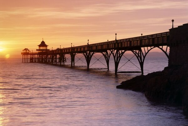 CLEVEDON PIER, Marine Parade, Clevedon, North Somerset. A view of the pier at sunset