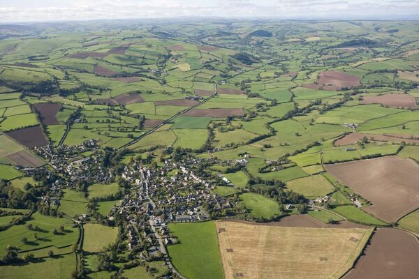 CLUN, Shropshire. Aerial view of the countryside. A small town nestling in the Shropshire Hills Area of Outstanding Natural Beauty. The remains of Clun Castle can be made out to the right of the town