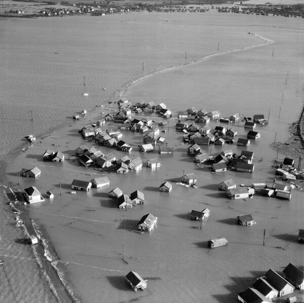 JAYWICK SANDS, Essex. Aerial photograph taken on 2nd February 1953 showing flooded housing following the great East Coast storm surge which hit the coast overnight on 31st January. At Jaywick, near Clacton, the sea rose a metre in 15 minutes