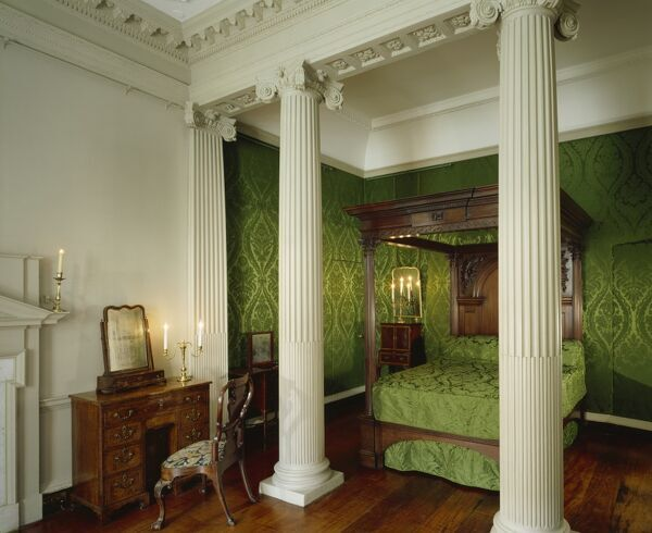 MARBLE HILL HOUSE, Middlesex. View of Henrietta Howard, Countess of Suffolk's Bedchamber showing the bedstead with green decor and dressing table