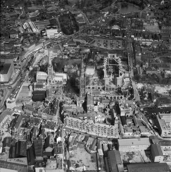 Coventry Cathedral, Warwickshire. The new Cathedral begins to take shape next to the shell of the old Cathedral. Photographed in March 1959, Aerofilms Collection