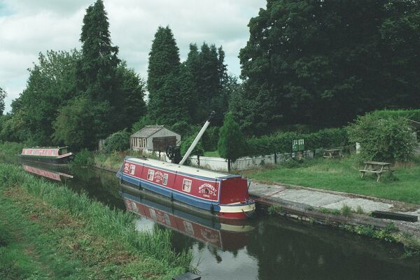 Picturesque view of boats on the canal with the crane behind. IoE 255688