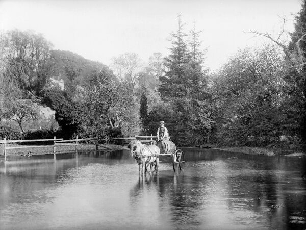 EWELME, Oxfordshire. A young man with a horse and cart, laden with a barrel, crossing the village pond. Probably the water carrier. Photographed by Henry Taunt sometime between 1860 and 1922