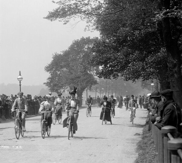 Hyde Park, Westminster, Greater London. A general view of both male and female cyclists in Hyde Park with spectators lining the route. York & Son, 1890s