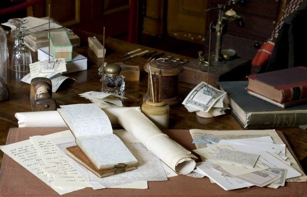 DOWN HOUSE, Kent. Detailed view of Darwin's worktable with letters, manuscripts and notebooks on display