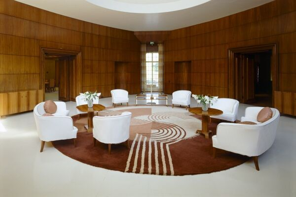 ELTHAM PALACE, London. Interior view of the Entrance Hall with the re-created 1930's Engstromer furniture and Dorn carpet