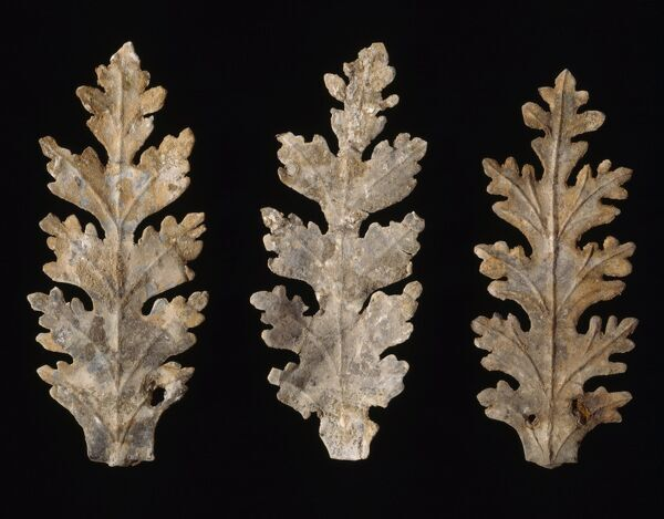 ELTHAM PALACE, London. Three gilded lead decorative leaves (originally from choir stalls in Henry VIII Chapel)