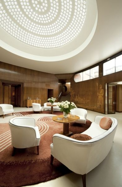 ELTHAM PALACE, London. Interior view. The Entrance Hall with Engstromer furniture and Dorn rug