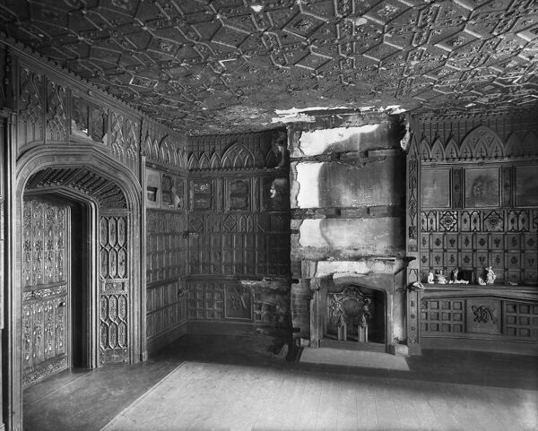 ERIDGE CASTLE, Rotherfield, East Sussex. Interior of the Smoking Room after a fire, looking towards the fireplace