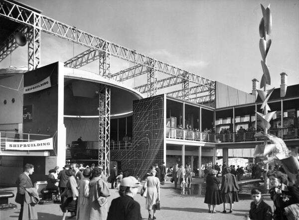 Festival of Britain, South Bank, Lambeth, London. Exterior view of part of the Shipbuilding Display at the Festival of Britain with a modern fountain to the right. Photographed in May 1951
